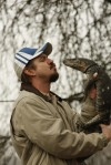 Eric accepts a kiss from his nile monitor